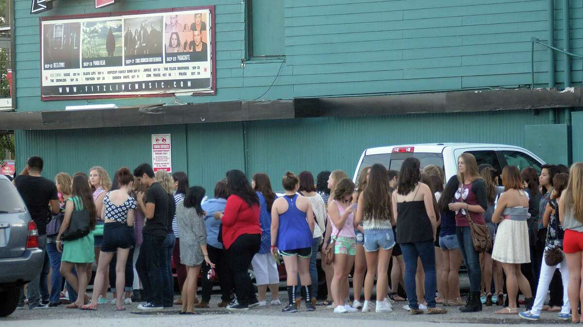Fans wait in line for the Nick Jonas show at Fitzgerald's on White Oak Monday Sept. 29, 2014.(Dave Rossman photo)