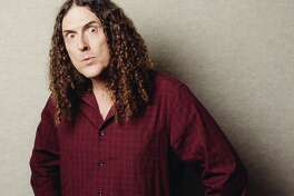 "In this July 17, 2014 photo, ""Weird Al"" Yankovic poses for a portrait in Los Angeles. Billboard reported that Yankovic's ""Mandatory Fun"" debuted at No. 1 this week with more than 80,000 units sold. That's almost double the amount his last album, ""Alpocalypse,"" sold in its debut week in 2011. (Photo by Casey Curry/Invision/AP)"