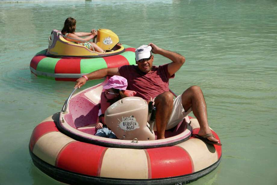 "Alex Padilla and his daughter, Peyton-Marie Padilla, enjoy the bumper boats at Malibu Grand Prix on Tuesday, Aug. 11, 2015. The park will be closing soon. ÒI came here as a child, I heard about the castle closing, and I wanted her to experience what I did as a kid. One of my favorite personal memories was coming here with my co-workers. This place allowed you to break the barriers of time and to be a kid again. To be a child again and not care,"" Padilla said. The park opened in 1978. Photo: Billy Calzada, San Antonio Express-News / San Antonio Express-News"