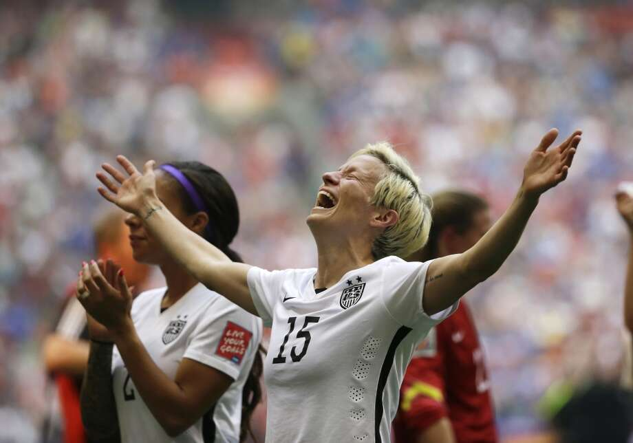 Rapinoe celebrates after the U.S. beat Japan 5-2 in the FIFA Women's World Cup final on her birthday in Vancouver, British Columbia, Canada, Sunday, July 5, 2015. She scored two goals with two assists in the tournament. (AP Photo/Elaine Thompson) Photo: Elaine Thompson, AP