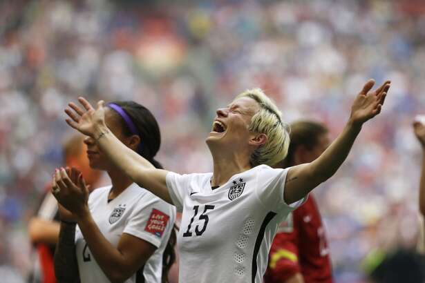 Rapinoe celebrates after the U.S. beat Japan 5-2 in the FIFA Women's World Cup final on her birthday in Vancouver, British Columbia, Canada, Sunday, July 5, 2015. She scored two goals with two assists in the tournament. (AP Photo/Elaine Thompson)