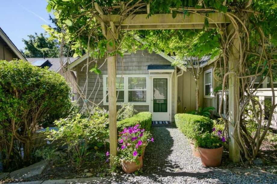 This historical tiny home, built in 1911, is just steps from Lake Washington. The 435 square-foot home is listed for $345,000, and was completely remodeled in 2002. The home includes vaulted ceilings and a private back patio.   You can see the full listing here. Photo: Courtesy Of Kirsten Robertson