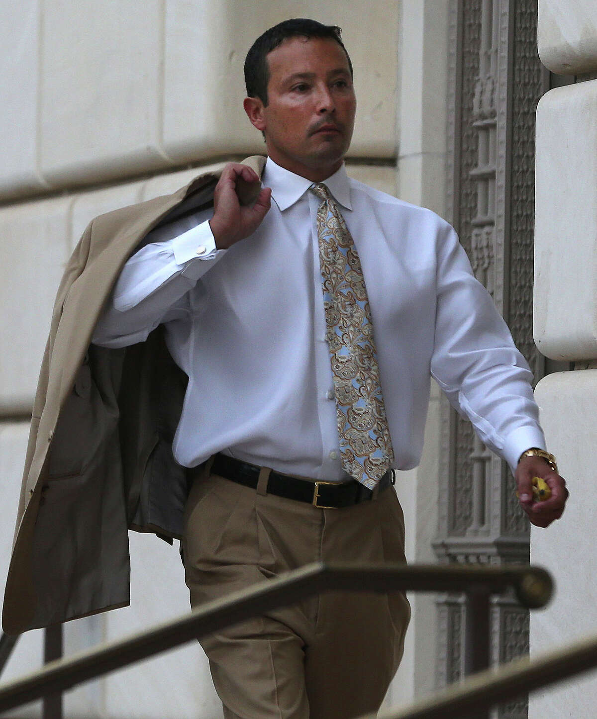 San Antonio oil and gas businessman Brian Alfaro enters the Hipolito F. Garcia Federal Building and United States Courthouse. Investors in Alfaro's company allege they've been defrauded and want the court to order Alfaro to turn over his personal financial records and to freeze any personal assets. Alfaro's lawyers contend the matter should be abitrated and not litigated as an adversary proceeding in bankruptcy court. U.S. Bankruptcy Judge Craig Gargotta is likey to take up the matter of whether Alfaro destroyed or threw out documents belonging to the company, which is now being overseen by a Chapter 11 trustee.