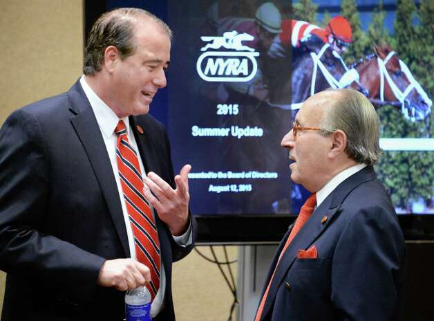 NYRA special advisor John Hendrickson, left, and vice chairman Michael Del Giudice, speak before the start of a board meeting at the Holiday Inn Wednesday August 12, 2015 in Saratoga Springs, NY.  (John Carl D'Annibale / Times Union) Photo: John Carl D'Annibale / 00032968A