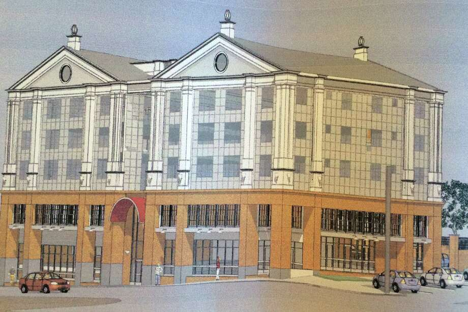 An architectural rendering of the proposed Phoenix Towers to be built at 434-56 Howe Ave. in Shelton, Conn. has been filed by Joseph Matto with the panning and Zoning Commission. The building would replace the four-story structure that collapsed during a January, 2014 fire. Photo: Contributed / Contributed Photo / Connecticut Post Contributed
