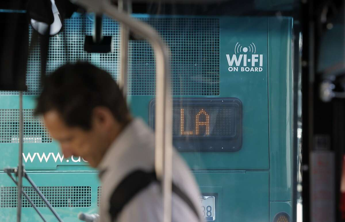 Wi-Fi enabled A/C transit buses wait in line to enter into the Transbay Terminal in San Francisco, Calif., on Wed. August 12, 2015.
