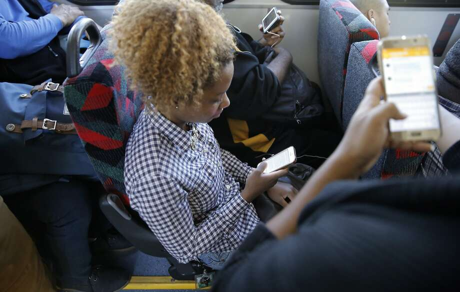 Nearly a third of Americans of all ages — 29 percent — are more intimate with their phones than another person. Photo: Michael Macor, The Chronicle