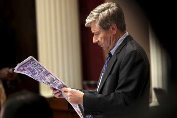 State Sen. George Runner, R-Lancaster, reads the morning paper after an all-night stay at the Capitol in Sacramento, Calif., Wednesday, Feb. 18, 2009.  Senate President Pro Tem Darrell Steinberg, D-Sacramento, confined Senate members to the Capitol overnight in an attempt to coax one Republican to vote for the stalled state budget package. (AP Photo/Rich Pedroncelli)