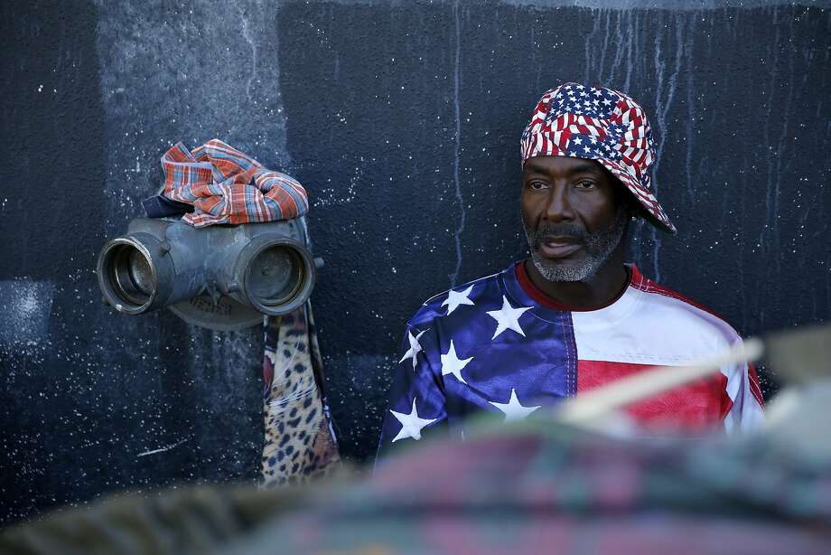 Steven, a homeless man, sits at his tent in a homeless encampment near Division and Bryant streets in San Francisco, California, on Wednesday, Aug. 12, 2015. Photo: Connor Radnovich, The Chronicle
