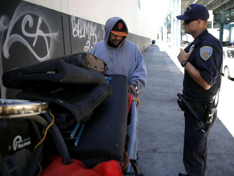 San Francisco Police Officer Suhrke tells Junior, a homeless man,  to move his encampment from the sidewalk near Division and Bryant streets in San Francisco, California, on Wednesday, Aug. 12, 2015. Photo: Connor Radnovich, The Chronicle