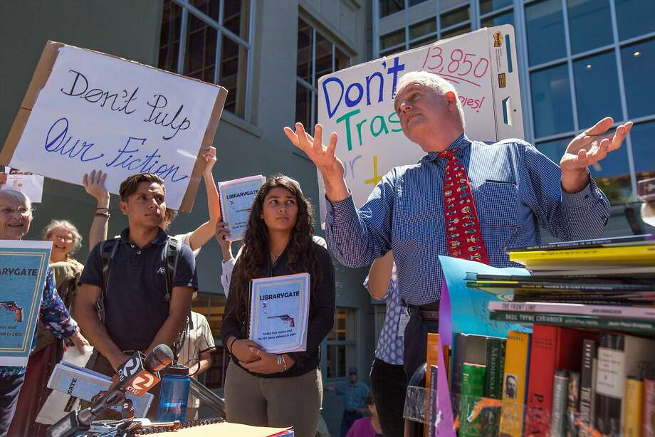 Berkeley councilmember Kriss Worthington, right, addresses Aug. 12, 2015 protest over at Berkeley Public Library over head librarian Jeff Scott's process or winnowing out old books. Scott has resigned over the controversy. Photo: Santiago Mejia, Special To The Chronicle