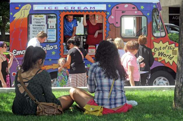 A large variety of food trucks line the plaza during the New York State Food Festival at the Empire State Plaza on Wednesday Aug. 12, 2015 in Albany, N.Y. (Michael P. Farrell/Times Union) Photo: Michael P. Farrell / 00032973A