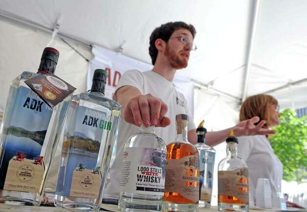 Nick Jones of Adirondack Distilling Company talks about their spirit offerings during the New York State Food Festival at the Empire State Plaza on Wednesday Aug. 12, 2015 in Albany, N.Y. (Michael P. Farrell/Times Union) Photo: Michael P. Farrell / 00032973A
