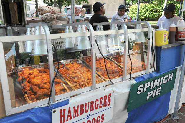 Food vendors get stocked up between the lunch and diner crowd during the New York State Food Festival at the Empire State Plaza on Wednesday Aug. 12, 2015 in Albany, N.Y. (Michael P. Farrell/Times Union) Photo: Michael P. Farrell / 00032973A