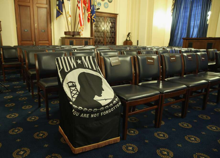 A seat is covered with a POW-MIA flag before the start of a House Veterans Affairs Committee hearing on Capitol Hill, June 23, 2014 in Washington, DC. The committee is hearing testimony on evaluating the capacity of the VA to care for veteran patients. (Photo by Mark Wilson/Getty Images)