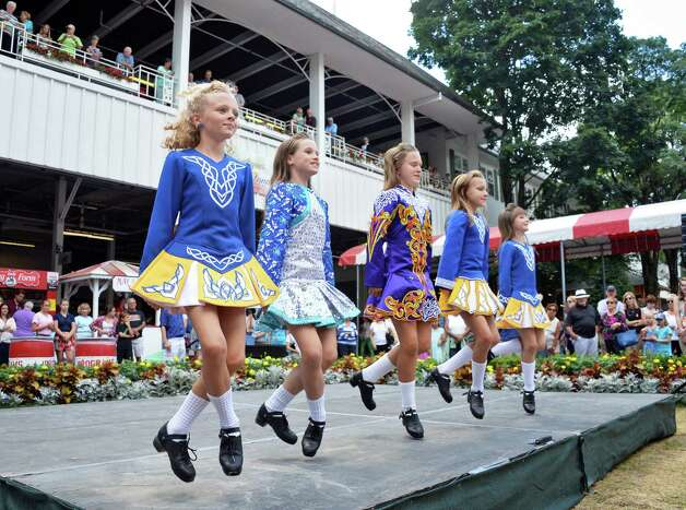 Dancers from the An Clar School of Irish Dance in Albany perform during International Heritage Series: Irish-American Day at the Saratoga Pavilion at Saratoga Race Course Wednesday August 12, 2015 in Saratoga Springs, NY.  (John Carl D'Annibale / Times Union) Photo: John Carl D'Annibale / 00032925A