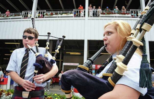 Pipers Lian Quinn, left,17, of Nassau and Anna Braun, 18, of Bethlehem perform with the Scotia-Glenville Pipe Band during International Heritage Series: Irish-American Day at the Saratoga Pavilion at Saratoga Race Course Wednesday August 12, 2015 in Saratoga Springs, NY.  (John Carl D'Annibale / Times Union) Photo: John Carl D'Annibale / 00032925A