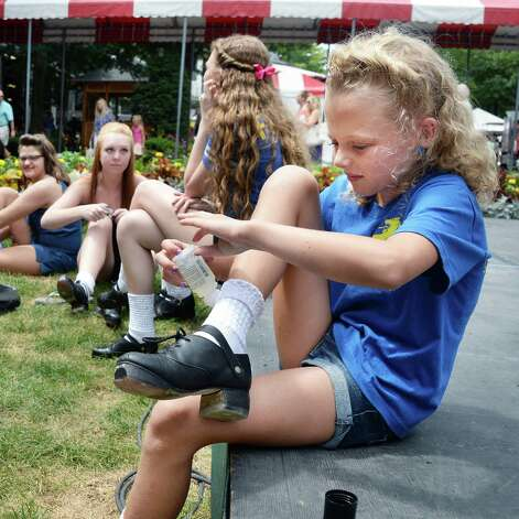 Ten-year-old dancer Mackenzie Clinton, right, of North Greenbush prepares to perform with the An Clar School of Irish Dance during International Heritage Series: Irish-American Day at the Saratoga Pavilion at Saratoga Race Course Wednesday August 12, 2015 in Saratoga Springs, NY.  (John Carl D'Annibale / Times Union) Photo: John Carl D'Annibale / 00032925A