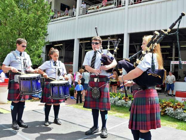 Members of the Scotia-Glenville Pipe Band, from left, Casey Braun, Troy Quinn, Lian Quinn and Anna Braun perform with the Scotia pipe band during International Heritage Series: Irish-American Day at the Saratoga Pavilion at Saratoga Race Course Wednesday August 12, 2015 in Saratoga Springs, NY.  (John Carl D'Annibale / Times Union) Photo: John Carl D'Annibale / 00032925A