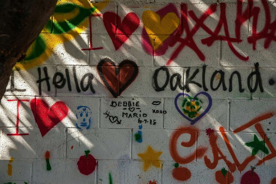 "Community members painted the walls with messages at the community garden and ""people's library"" next to the abandoned Miller Avenue Library, Wednesday, Aug. 12, 2015, in Oakland, Calif. Photo: Santiago Mejia, Special To The Chronicle"