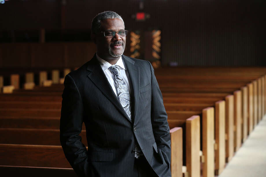 Rev. Kenneth Kemp poses at Antioch Missionary Baptist Church, Tuesday, June 23, 2015. He is the senior pastor at the church that was founded in 1935. Photo: Jerry Lara, Staff / For The San Antonio Express-News / ©2015 San Antonio Express-News