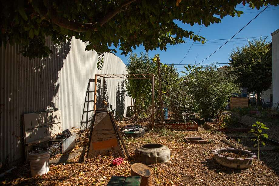 Locals built the community garden next to the abandoned Miller Avenue Library, Wednesday, Aug. 12, 2015, in Oakland, Calif. Cuellar helps Yassin maintain the garden. Photo: Santiago Mejia, Special To The Chronicle