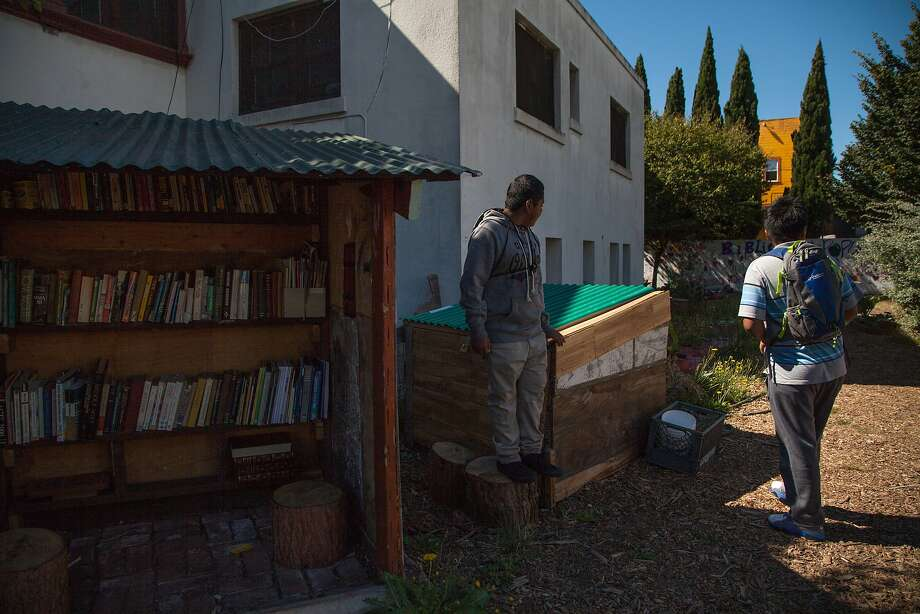 From left: Jovanny Rios, age 12, and Isaac Sanchez, age 13, check out the garden, Wednesday, Aug. 12, 2015, in Oakland, Calif. Both help maintain it. Photo: Santiago Mejia, Special To The Chronicle