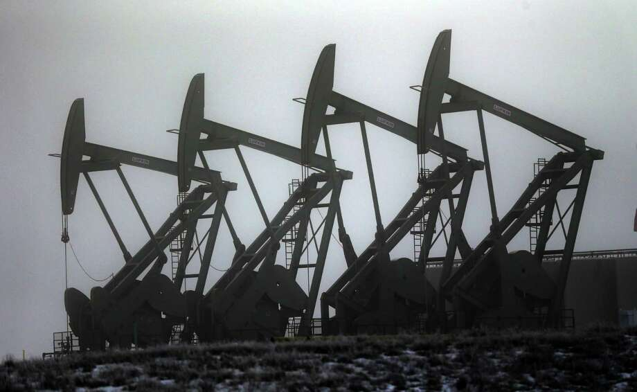 Oil pump jacks work in unison in Williston, N.D. Never mind dropping oil prices. U.S. producers are pushing harder than ever for the right to sell U.S. crude oil overseas. Photo: Eric Gay, STF / AP