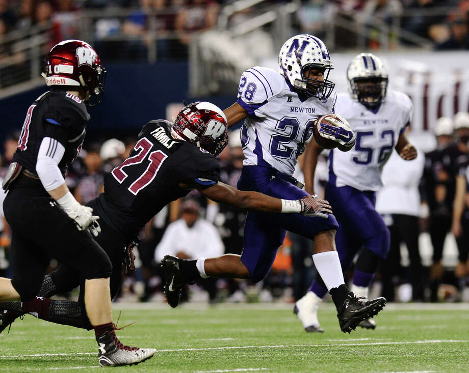 Newton's Jaron Hanks, No. 28, tries to outrun the Wildcats' Mike Reason, No. 21, during Thursday's championship game against Waskom. The Newton Eagles played against the Waskom Wildcats at the AT&T Stadium in Arlington, TX, for the 3A Division II championship on Thursday afternoon. Photo taken Thursday 12/18/14 Jake Daniels/The Enterprise   Manditory Credit, No Sales, Mags Out, TV OUT, Web: AP Members Only Photo: Jake Daniels / ©2014 The Beaumont Enterprise/Jake Daniels