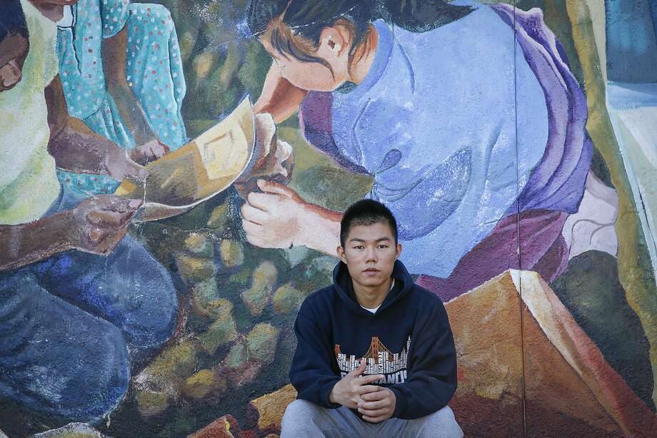 Recent San Francisco International High graduate Zezhou He, 19, is  seen at his former high school Wednesday, Aug. 12, 2015. He was accepted to San Francisco State University and planned to begin later this month, but is no longer eligible because he has not passed the California High School Exit Exam. The college hopeful planned to take the exam last month until it was cancelled, leaving him in limbo. Photo: Loren Elliott, The Chronicle