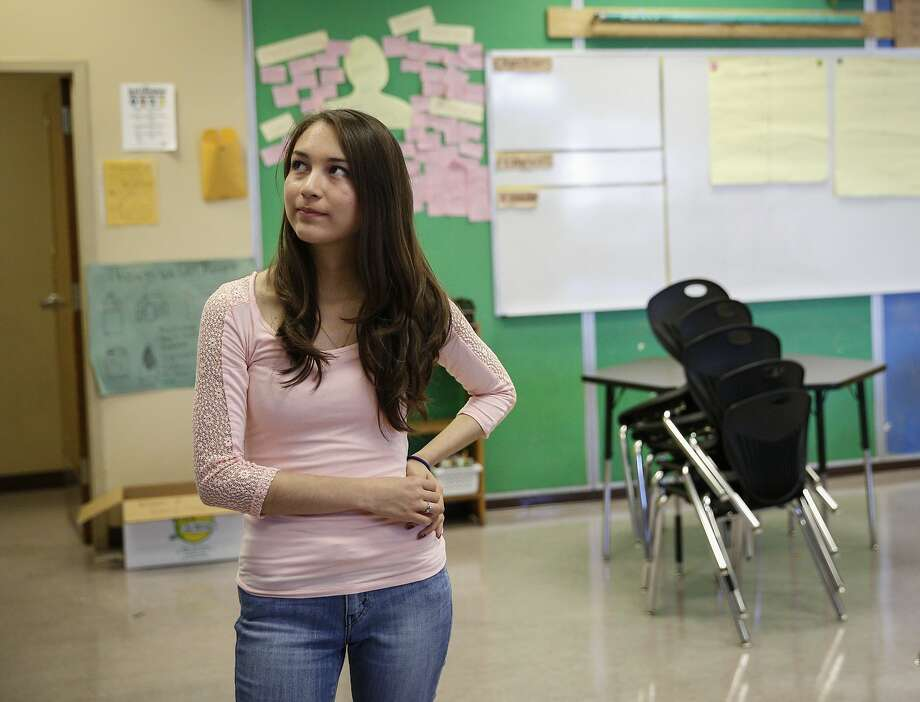 Recent San Francisco International High graduate Krissia Martinez, 19, is seen reminiscing in her former 10th grade history classroom Wednesday, Aug. 12, 2015. She was accepted to San Francisco State University and planned to begin later this month, but is no longer eligible because she has not passed the California High School Exit Exam. The college hopeful planned to take the exam last month until it was cancelled, leaving her in limbo. Photo: Loren Elliott, The Chronicle