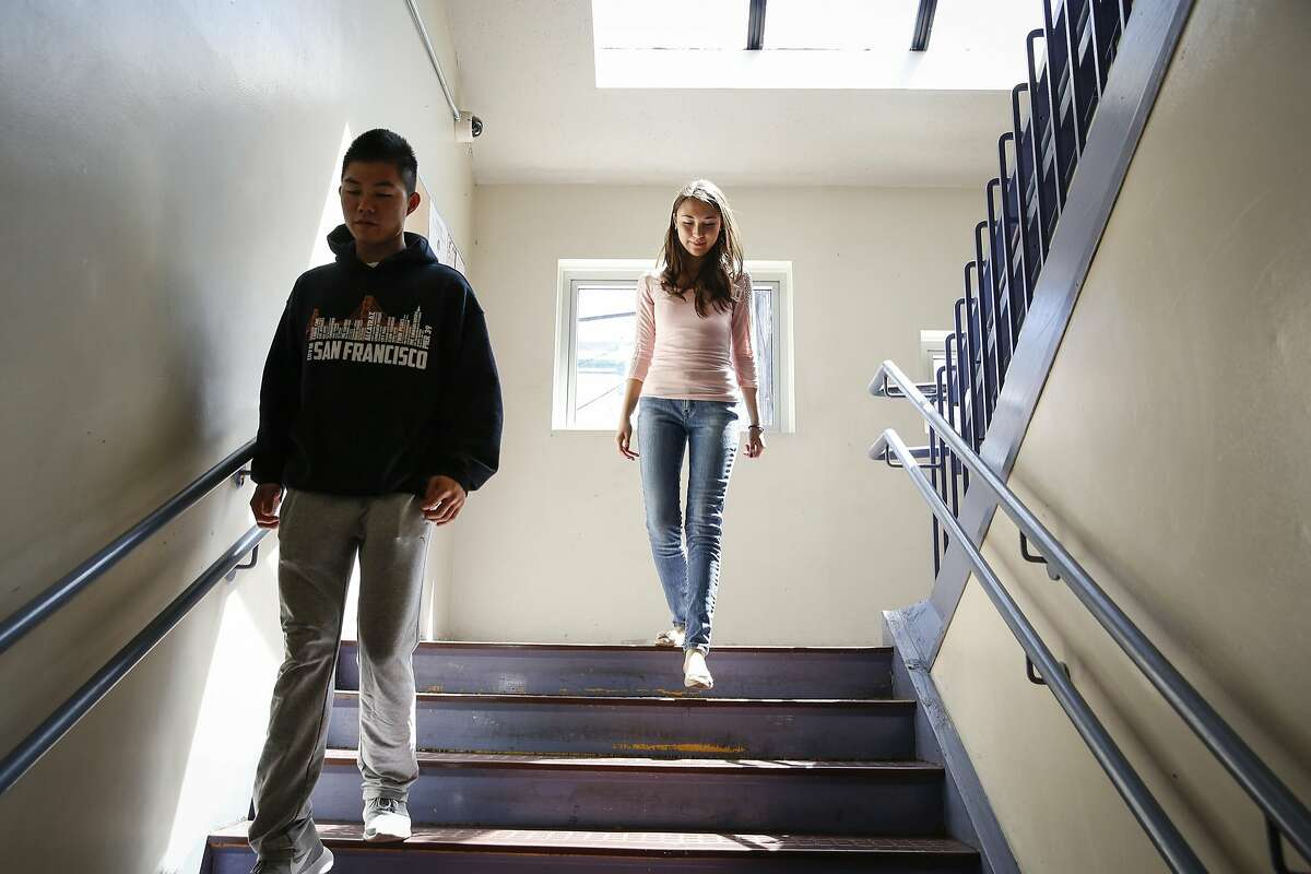 Recent San Francisco International High graduates Zezhou He (left), 19, and Krissia Martinez, 19, are seen at their former high school Wednesday, Aug. 12, 2015. Both were accepted to San Francisco State University and planned to begin later this month, but are no longer eligible because they have not passed the California High School Exit Exam. The college hopefuls planned to take the exam last month until it was cancelled, leaving them in limbo.