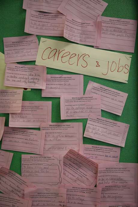 Student-written notes detailing career aspirations are seen on the wall of a history classroom at San Francisco International High School on Wednesday, Aug. 12, 2015. Recent graduates Krissia Martinez, 19, and Zezhou He, 19, have had their future dreams derailed because of the lost opportunity to attend San Francisco State University this fall. The cancellation of the California High School Exit Exam prevents them from getting their diplomas. Photo: Loren Elliott, The Chronicle