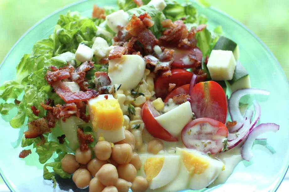 This July 13, 2015, photo, shows late summer cobb salad in Concord, N.H. This Cobb salad has chickpeas and eggs as the main proteins, and the traditional bacon as well, which could be left out for a vegetarian version. (AP Photo/Matthew Mead) ORG XMIT: MER2015080708205601 Photo: Matthew Mead / FR170582 AP