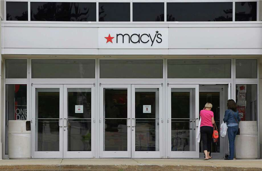 In this July 10, 2015, photo, shoppers walk into a Macy's department store at the Hanover Mall in Hanover, Mass. Macy's Inc. reports quarterly financial results before the market opens on Wednesday, Aug. 12, 2015. (AP Photo/Stephan Savoia) ORG XMIT: NYBZ904 Photo: Stephan Savoia / AP