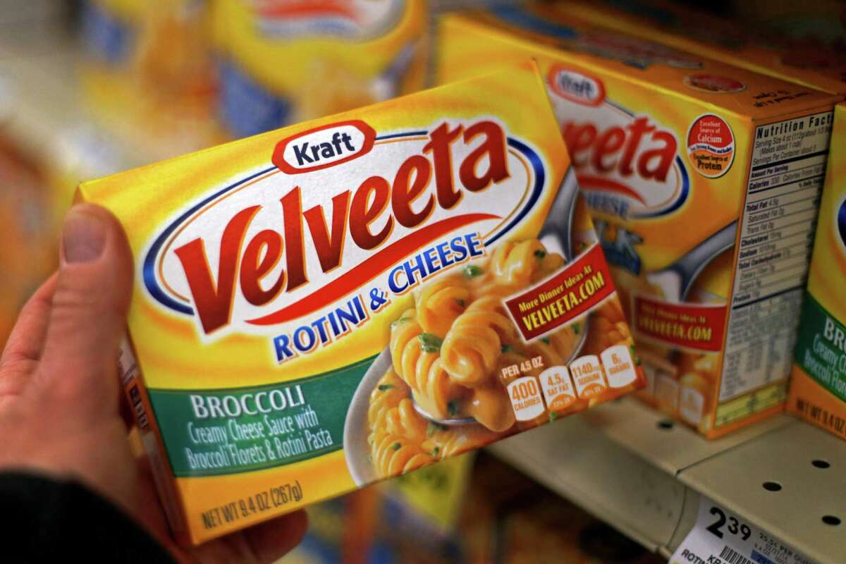 FILE - This Tuesday, April 29, 2014, file photo, shows a display of Kraft Velveeta rotini and cheese at a grocery market in Pittsburgh. On Wednesday, Aug. 12, 2015, Kraft Heinz announced it is cutting about 2,500 jobs as part of its plan to slash costs after the food companies combined. (AP Photo/Gene J. Puskar, File) ORG XMIT: NY111
