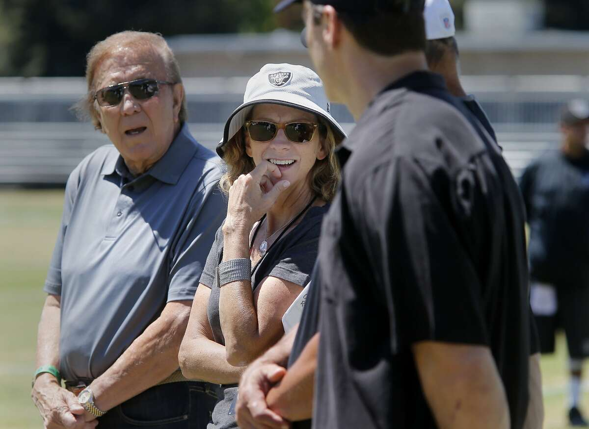 Beth Mowins is surrounded by men including fellow broadcaster Tom Flores (left) as she watches a workout Wednesday August 12, 2015. Beth Mowins is the new play by play announcer for the Oakland Raiders for their preseason games. She watched a practice recently in Napa, Calif. where the team has training camp.