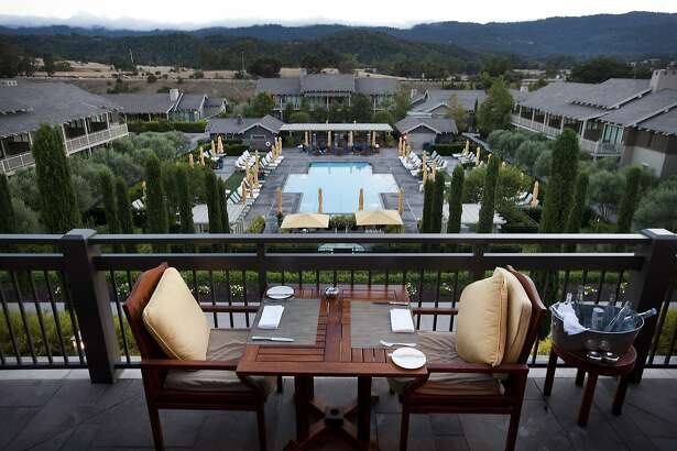 A table is set on the terrace of Madera restaurant overlooking the pool with the Santa Cruz mountains in the background at the Rosewood Sand Hill Hotel in Menlo Park, CA Monday, August 10, 2015.