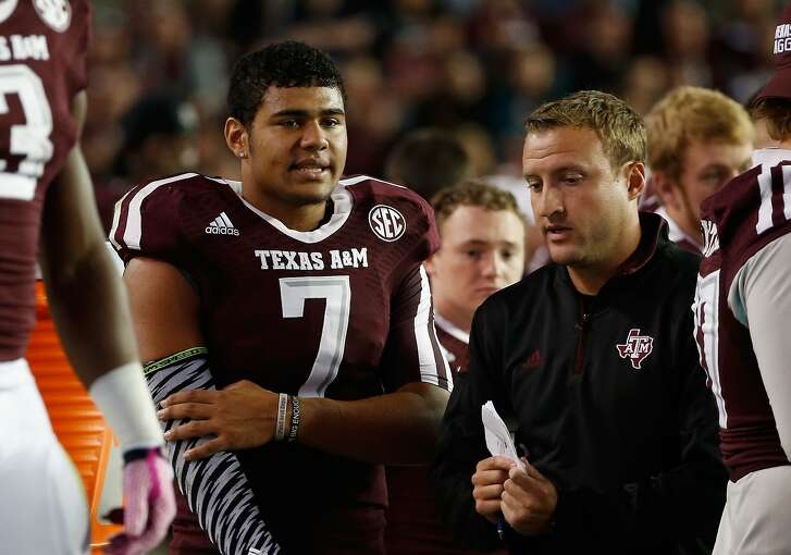COLLEGE STATION, TX - OCTOBER 11:  Kenny Hill #7 of the Texas A&M Aggies chats with quarterbacks coach Jake Spavital during the first half of their game against the Mississippi Rebels at Kyle Field on October 11, 2014 in College Station, Texas.  (Photo by Scott Halleran/Getty Images)