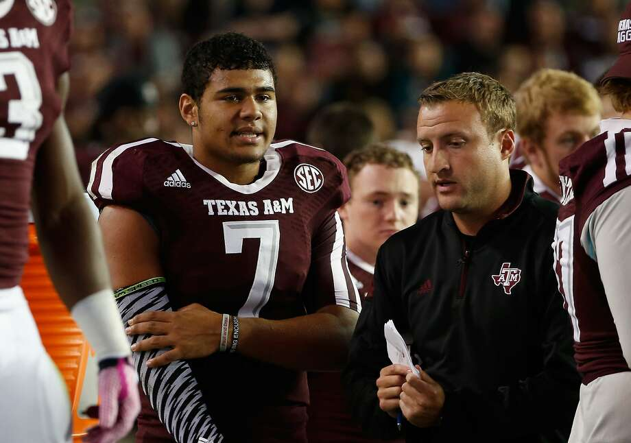COLLEGE STATION, TX - OCTOBER 11:  Kenny Hill #7 of the Texas A&M Aggies chats with quarterbacks coach Jake Spavital during the first half of their game against the Mississippi Rebels at Kyle Field on October 11, 2014 in College Station, Texas.  (Photo by Scott Halleran/Getty Images) Photo: Scott Halleran, Getty Images