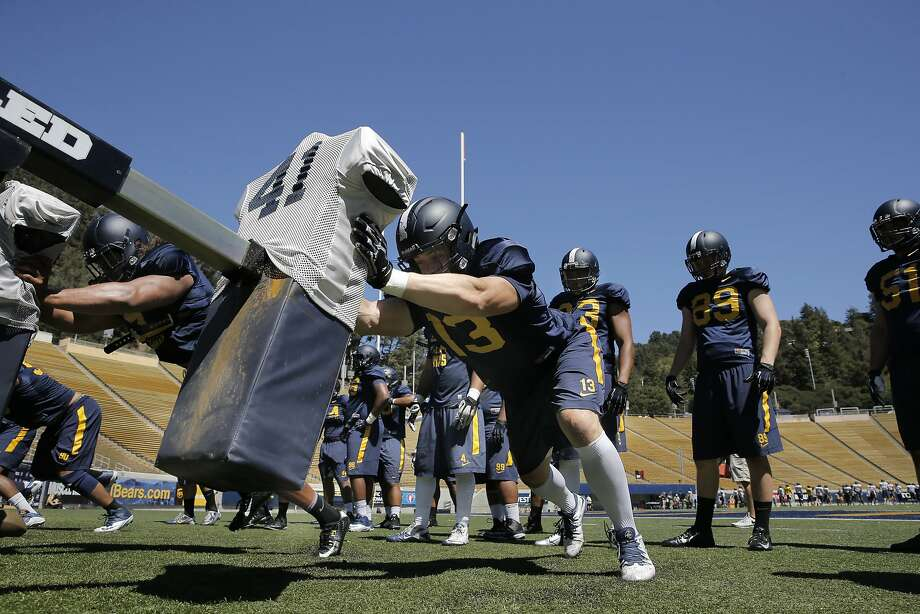 Cal Berkeley's defensive end Kyle Kragen, 13 runs drills on the blocking sled during practice at Memorial Stadium in Berkeley, Calif., on Wed. August 12,  2015. Photo: Michael Macor, The Chronicle