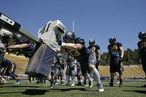 Cal Berkeley's defensive end Kyle Kragen, 13 runs drills on the blocking sled during practice at Memorial Stadium in Berkeley, Calif., on Wed. August 12,  2015.