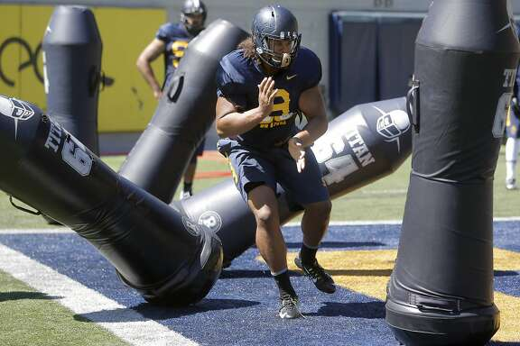 Cal Berkeley's defensive tackle James Looney, 9 runs drills during practice at Memorial Stadium in Berkeley, Calif., on Wed. August 12,  2015.