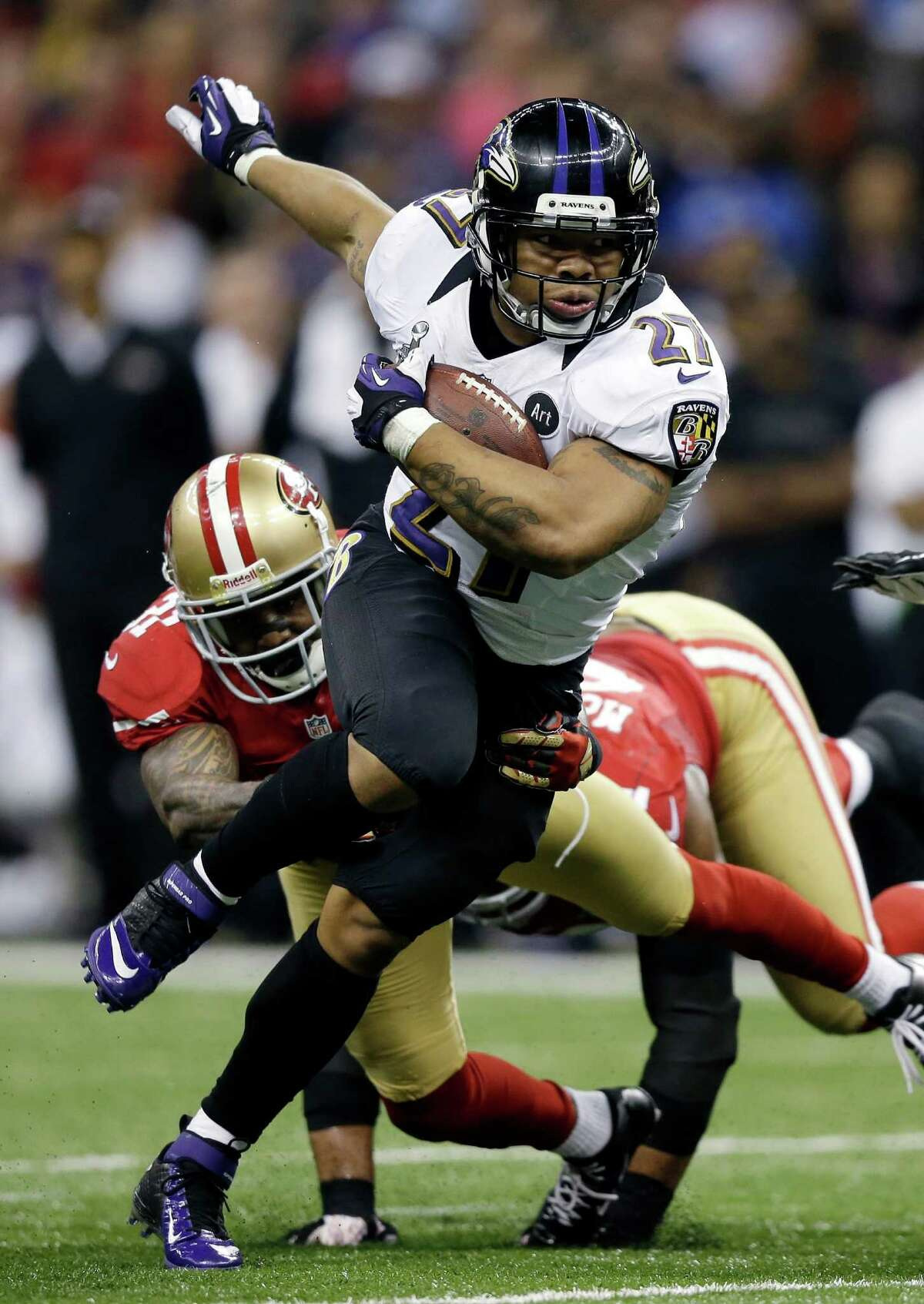 In this Feb. 3, 2013, file photo, Baltimore Ravens running back Ray Rice (27) rushes away from San Francisco 49ers defensive end Ray McDonald (91) during the first half of the NFL Super Bowl XLVII football game in New Orleans. It's an NFL fact of life: If a player has talent, a team can find a place for him, no matter how bad his off-the-field profile. Ray Rice is testing that maxim, as much for his deed as the fact that it's documented on video. He's suspended now, but can he rehab his image enough to come back on the field?