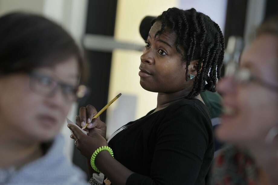 New SFUSD teacher Ashli Duncan takes notes at a professional development meeting for staff at Bessie Carmichael Elementary School in SoMa. Photo: Lea Suzuki, The Chronicle