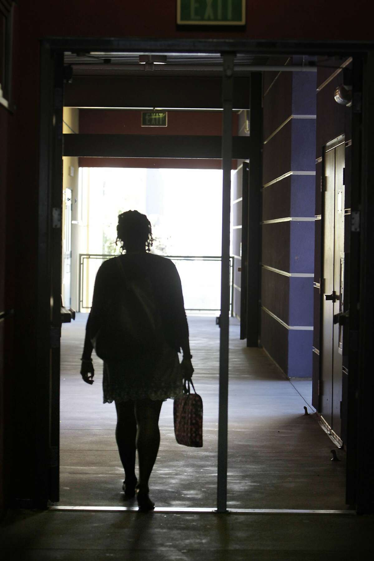 New SFUSD teacher Ashli Duncan walks through the hallway as she walks to a professional development meeting for staff at Bessie Carmichael Elementary School on Wednesday, August 12, 2015 in San Francisco, Calif.