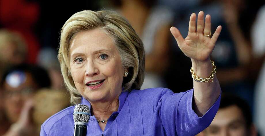 Democratic presidential candidate Hillary Rodham Clinton answers questions after announcing her college affordability plan, Monday, Aug. 10, 2015, at the high school in Exeter, N.H. (AP Photo/Jim Cole) Photo: Jim Cole, STF / AP