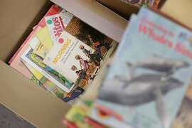 Books that new SFUSD teacher Ashli Duncan acquired for her second grade classroom sit in a box next to other books given to her from an outgoing teacher at Bessie Carmichael Elementary School on Wednesday, August 12, 2015 in San Francisco, Calif.
