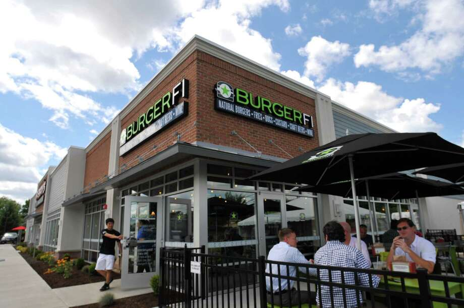 A view of Burgerfi during its opening day on Wednesday, Aug 12, 2015, at Burgerfi in Latham, N.Y. (Phoebe Sheehan/Special to The Times Union) Photo: PS / 00032985A