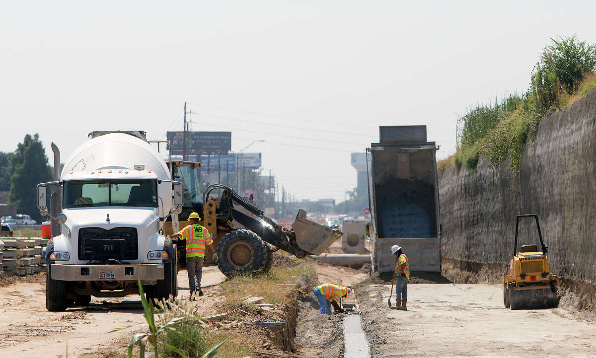 A crew works Wednesday along U.S. 290. TxDOT said the temporary relocation of a gas line and changes to the storm sewer system to accommodate Centerpoint Energy cost the project an additional $353,639.